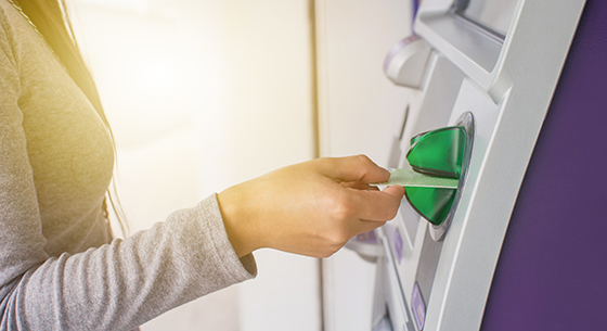 person putting their card into an ATM