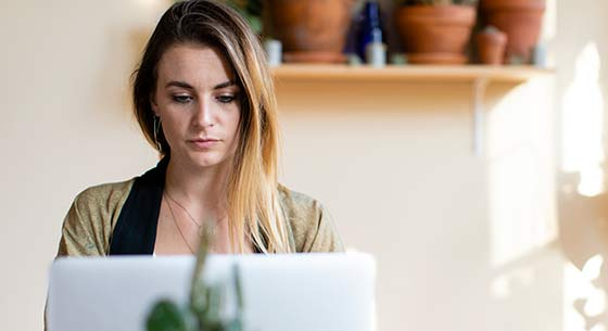 woman on a laptop opening an account from home