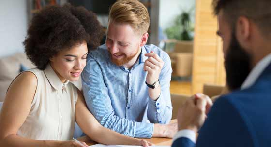 Couple meeting with local mortgage lender