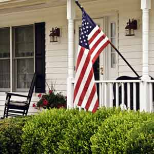 American flag hanging on a white house