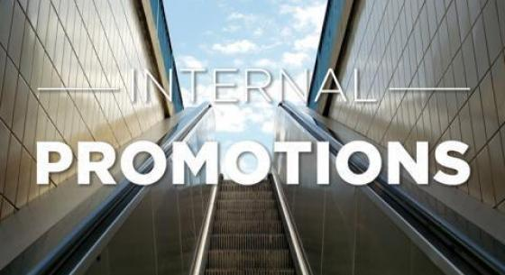 Internal Promotions in white text or an escalator opening up to a blue sky