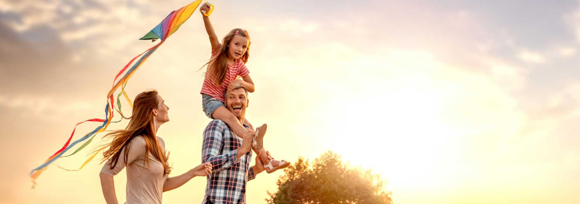 Family Running with Kite, child on dad's shoulders